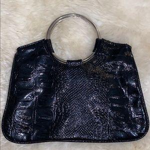 Black snakeskin handbag with silver metal hoops